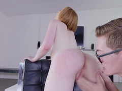 A redhead sucks a cock and she is fucked in her wet pussy