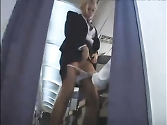 Stewardess fellates shaft on flat