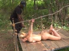 Pegged down beauty toyed by black maledom