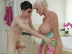 Big boobed granny fools around with a young porn hunk