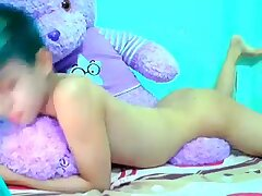 Blue haired asian boy on cam