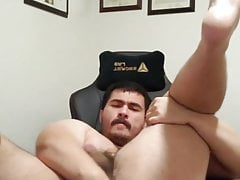 Cub fingers his ass and cums