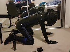 Caged latex gimp testing out a new fucking machine