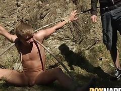 Gay blonde twink restrained outdoors before giving a sloppy blowjob