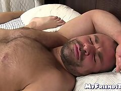 Hunky bear receives feet licking while masturbating