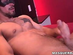 Handsome masked homo strips naked and starts to masturbate