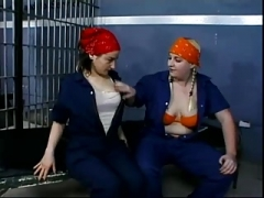 A duo gals wearing a bandana having sex in jail