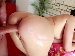 Young man waters Anikka Albrite's rear and penetrates her