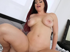 Busty redhead rides BF's phallus with a toy inside her ass