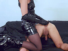 latex milf dominatrix prostate milking with a dildo - touches the cum in his ass