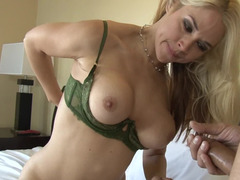 Blonde MILF tests her sex skills of her stepdaughter's boyfriend