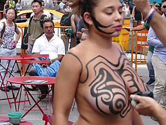 stunning bare-chested woman Getting Painted