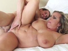 Big titted woman likes to suck balls