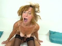 Drilling her mature pussy from behind has the slut moaning