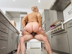 Lusty cougar Ryan Keely fucked by younger guy in the kitchen