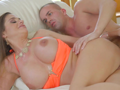Big-breasted lady has a talent that helps her to satisfy her man