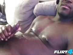 Black guy covers his chest in jizz