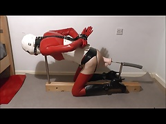Sissy Latex bondage fucking machine with huge dildo