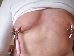 man using nipple clamp vibrator