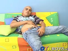 Kinky skinhead latino Cristobal is on the sofa wanking dick