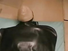 Slave totally latex covered breathplay vacuum hood